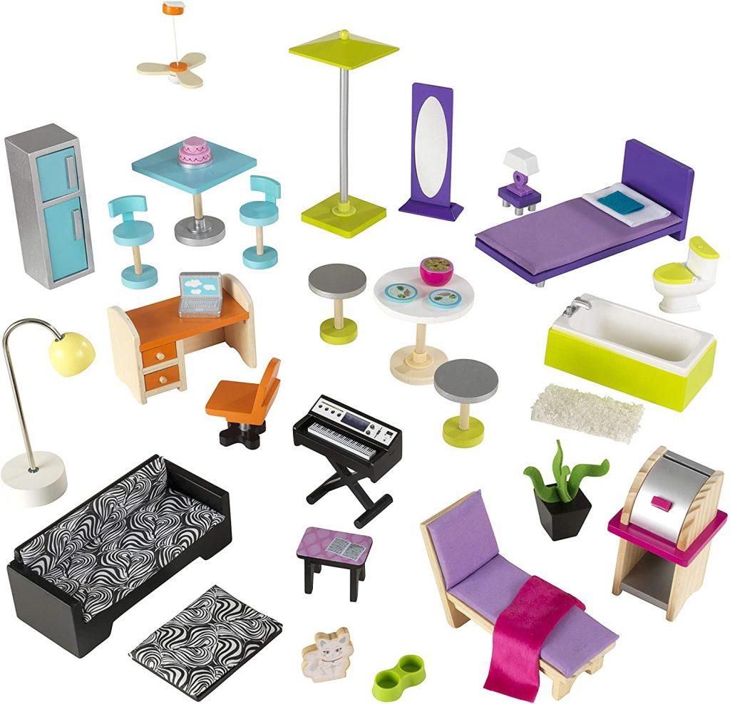 La maison de poupées en bois Uptown est livrée avec 36 accessoires.