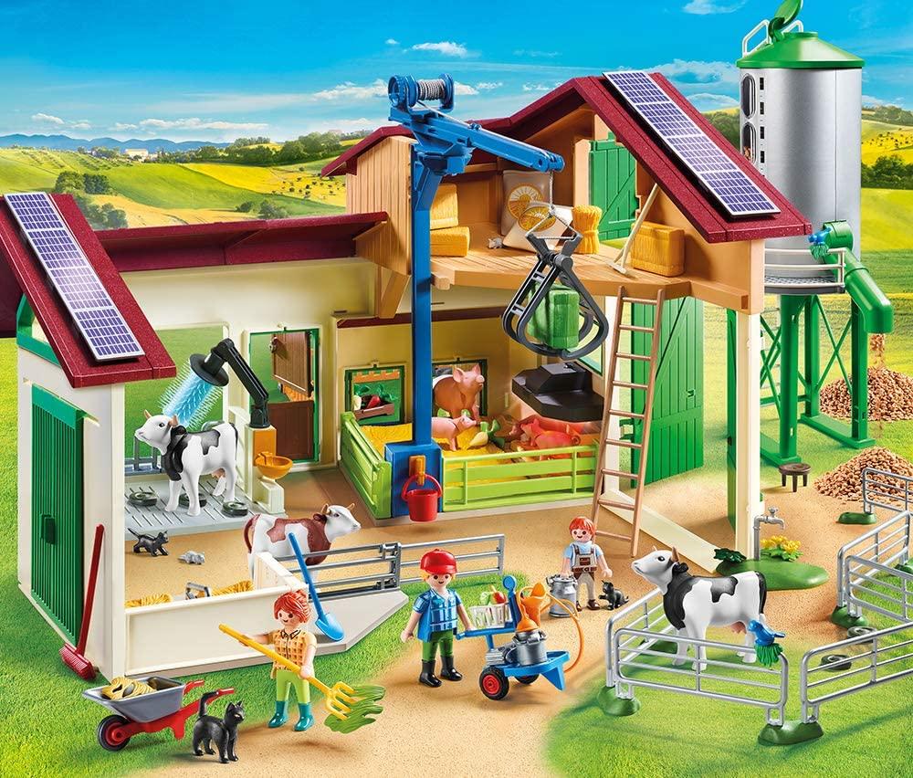 La ferme Playmobil Country comporte un silo et plusieurs animaux.