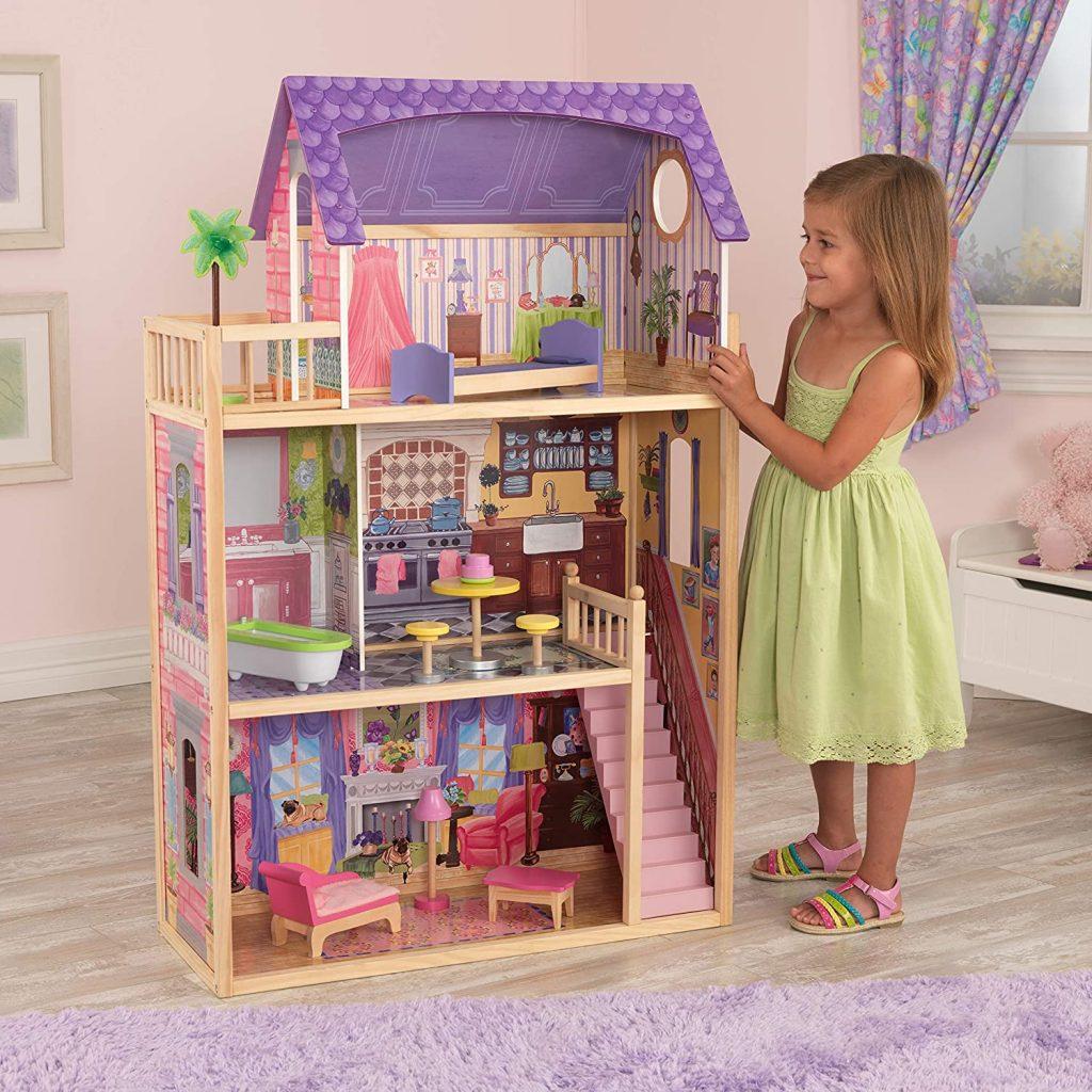 La maison de poupées en bois Kayla Kidkraft est de couleur rose et violette.