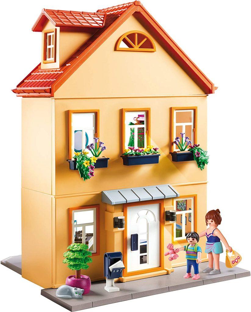 La maison de ville Playmobil a une façade fleurie.