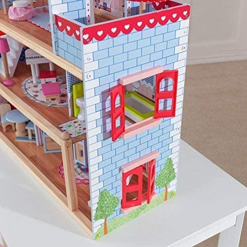 La maison de poupées en bois Chelsea a des fenêtres rouges.
