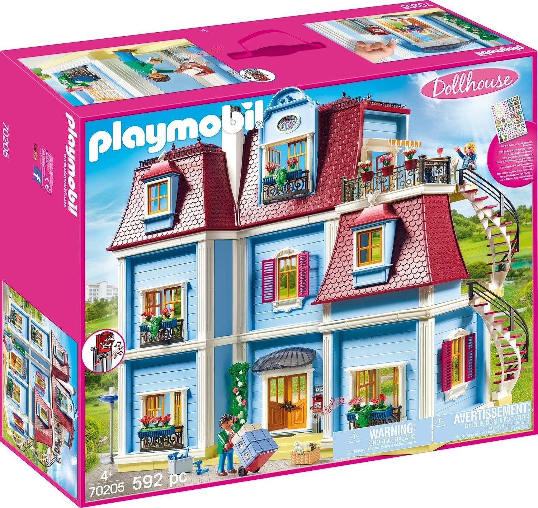 Cette grande maison traditionnelle Playmobil a une façade de couleur bleu.